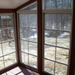 Inside view of 4 track vertical sliding vinyl windows with aluminum framing